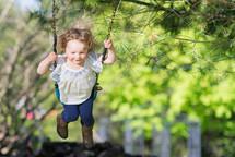 toddler girl on a swing