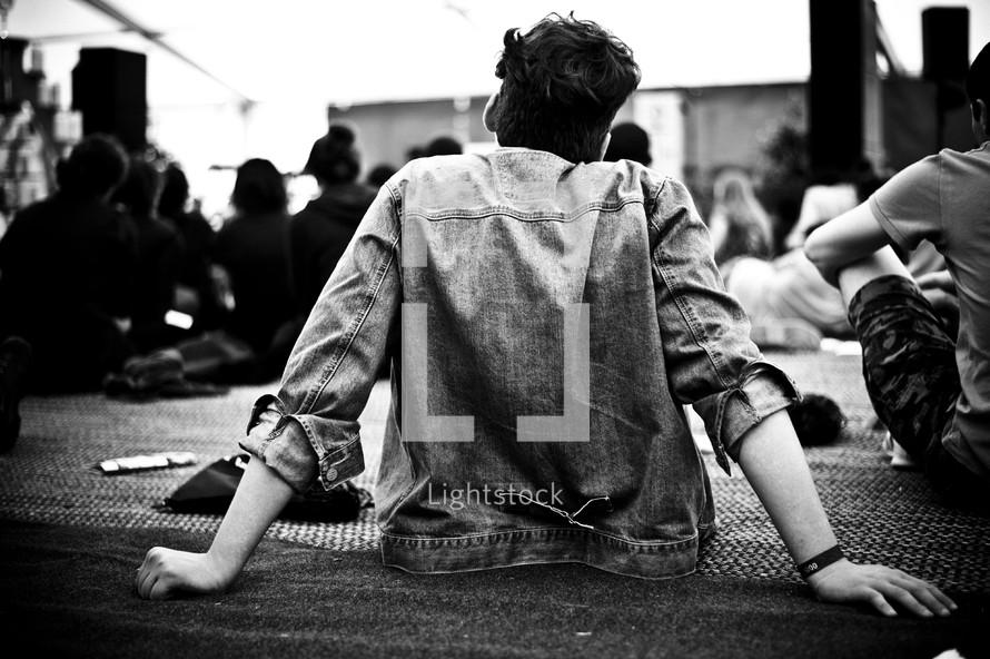 Teens sitting on the floor.
