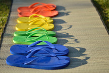 flip flops drying on a mat