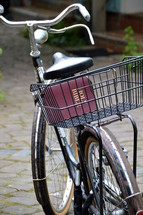 old bikes with a bible in the bicycle basket, 