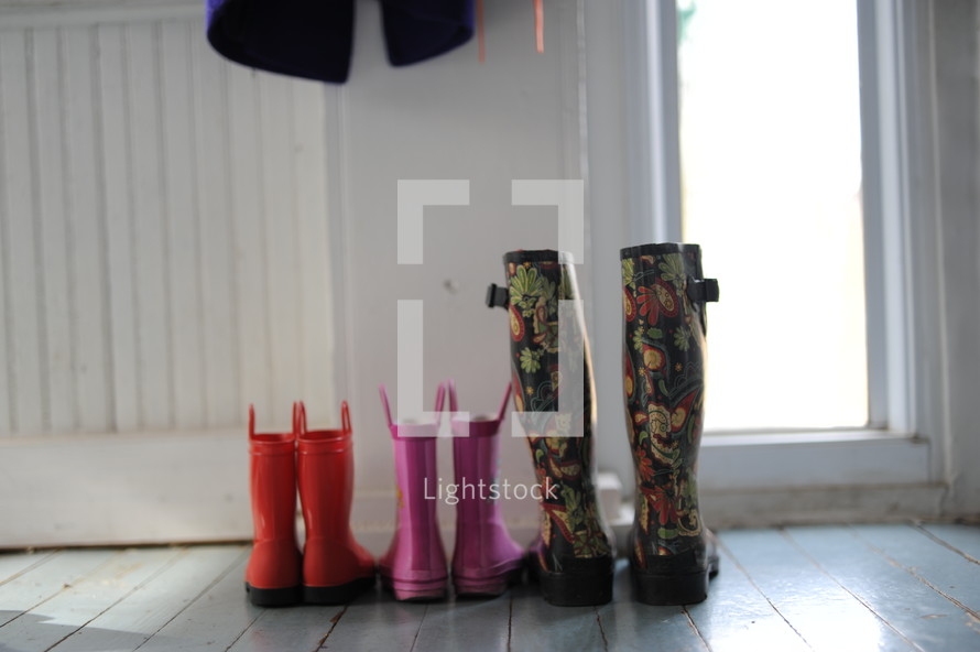 rain boots on a mudroom floor