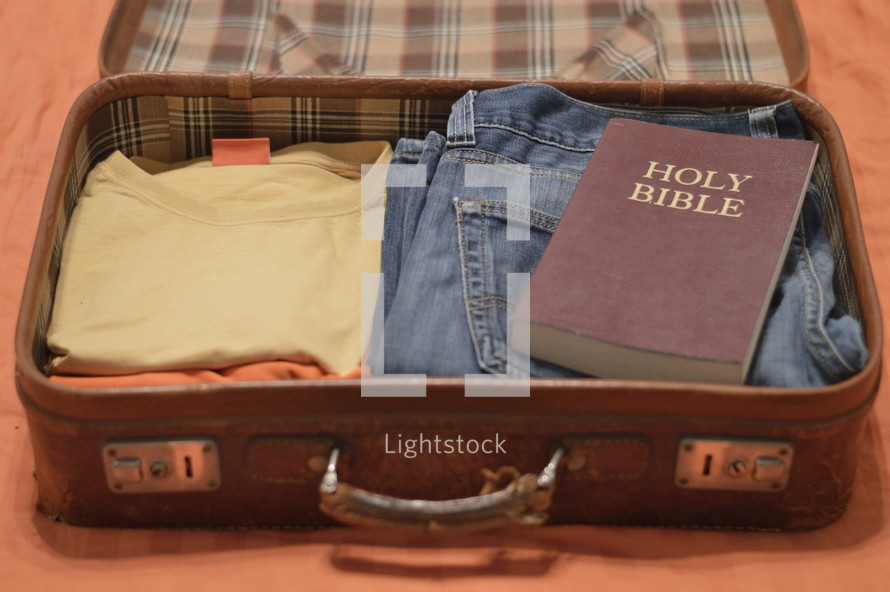 Holy Bible packed in a suitcase