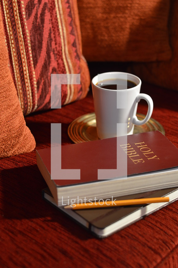 coffee, Bible, and journal on a couch - comfortable bible study at home