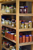 jars of preserved food on a pantry shelf