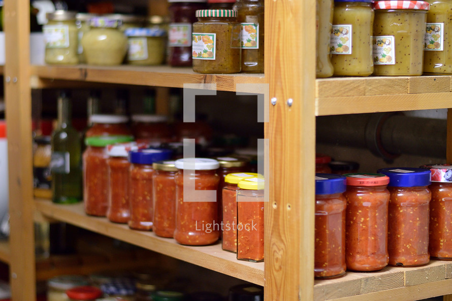 jars of preserved food on pantry shelfs