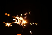sparks from a sparkler at night