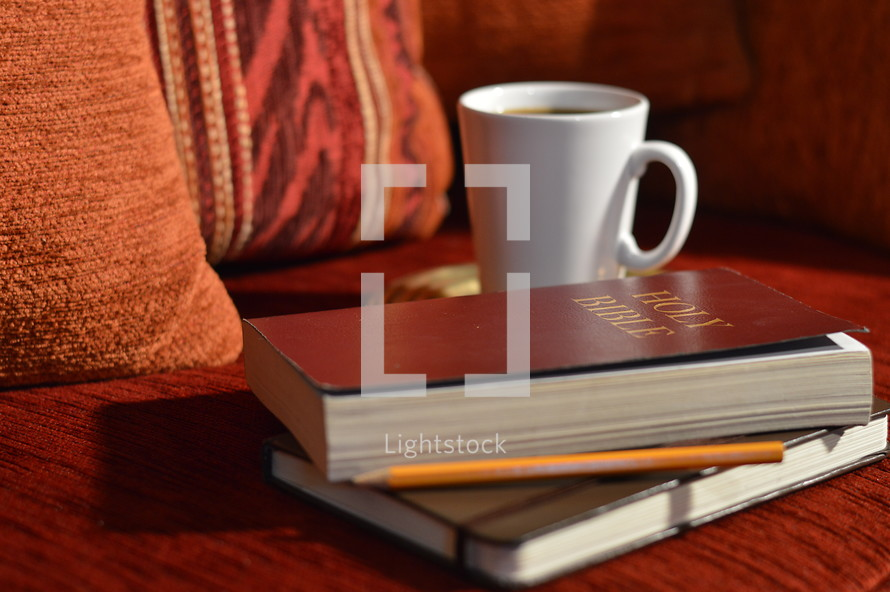 coffee mug, Bible, journal, and pencil on a couch - comfortable bible study at home