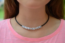 Child of God necklace around a woman's neck