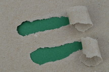 ripped paper revealing green blank space for words