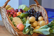 basket filled with selection of different fruits and vegetables
