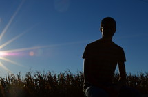 young man in a corn field