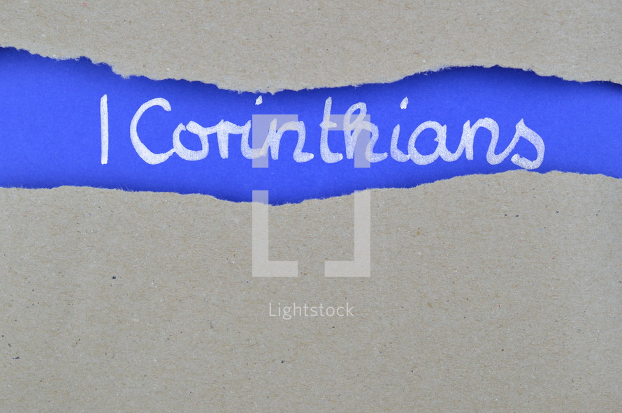Title 1 Corinthians exposed under gray torn paper