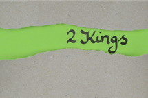 Title 2 Kings - torn open kraft paper over green paper with the name of the book 2 Kings