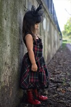 a little girl outdoors dressed up