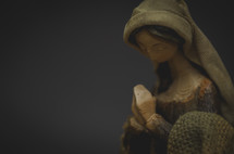 a praying figurine of Mary