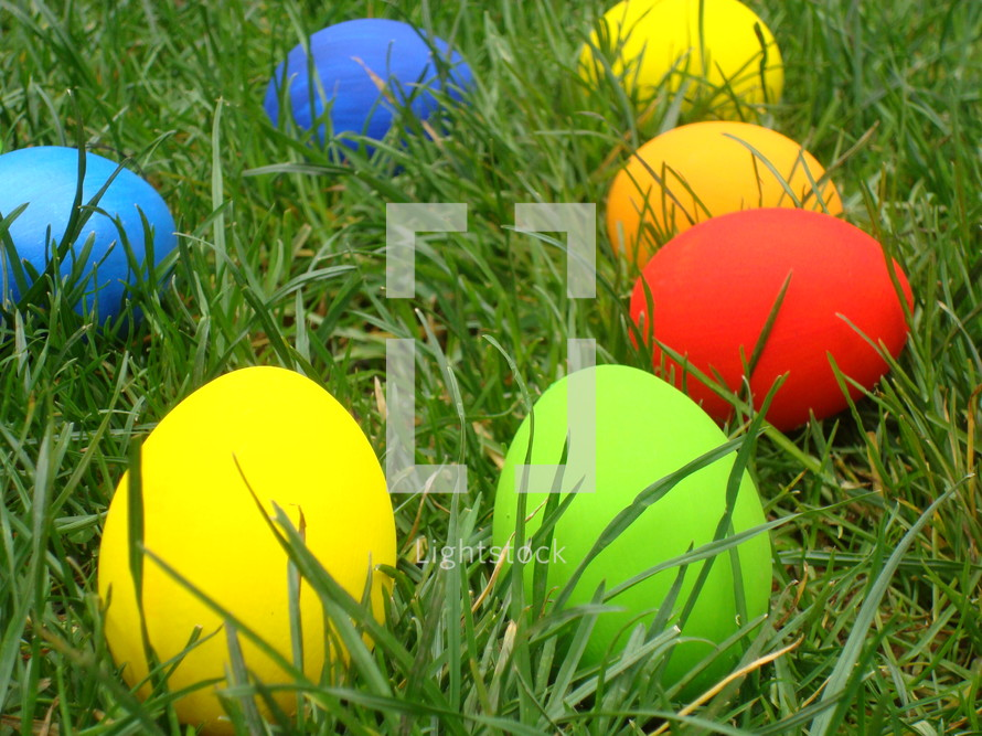 Multicolored Easter eggs in the grass,
