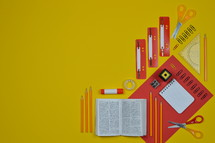 office supplies on red and yellow with Bible