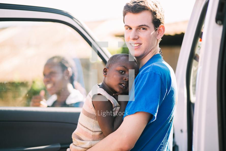 child hugging a man