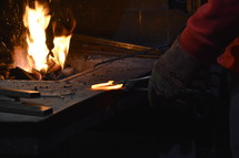 blacksmith working with a red-hot horseshoe