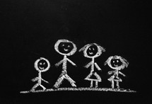 A chalk drawing of a stick figure family.