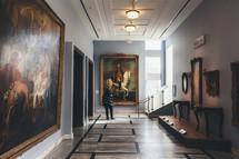 a woman enjoying art at an art museum