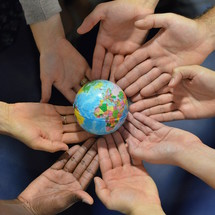 ínternational group holding a globe together.