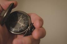 a man holding a pocket watch
