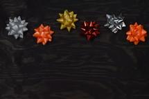 bows on black wood background