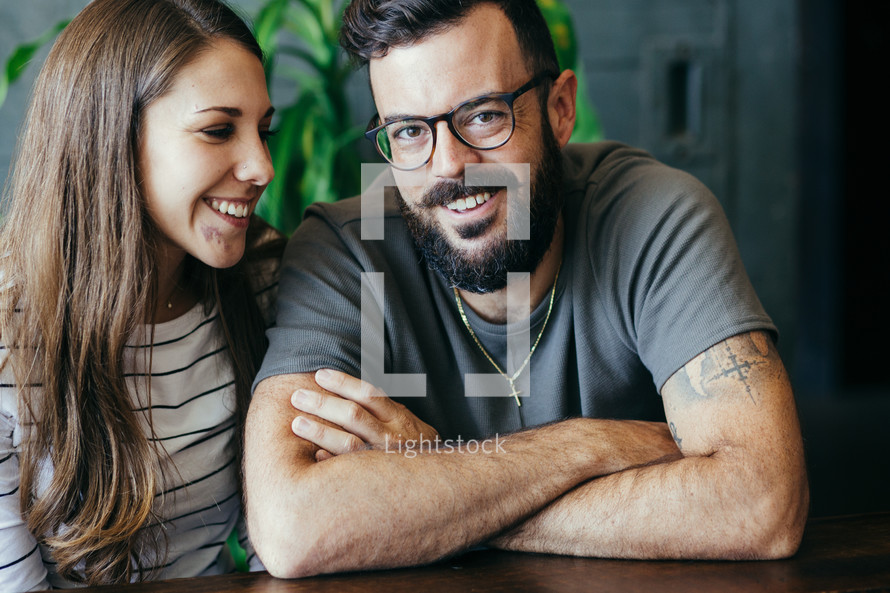 head-shots of a happy couple