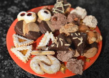 plate with different christmas cookies to share with friends and family.