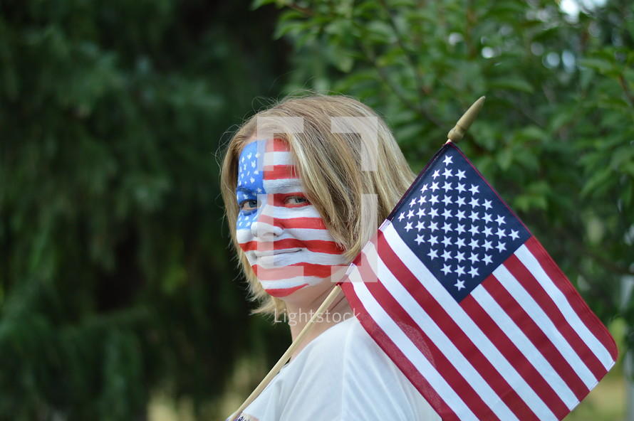 woman with American flag painted on her face