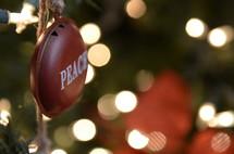 peace ornament on a Christmas tree