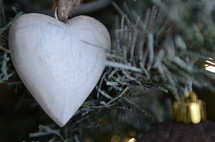 wooden heart ornament on a Christmas tree