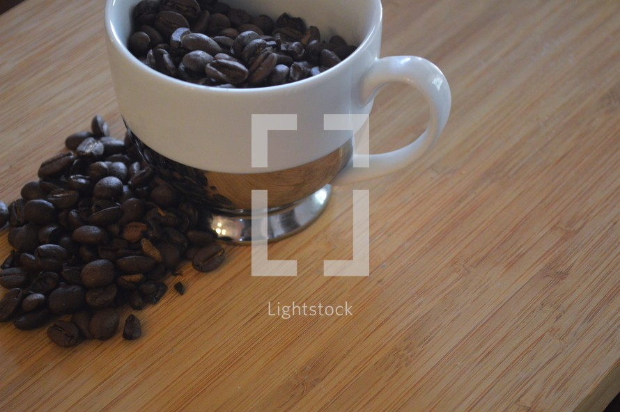 coffee cup filled with coffee beans