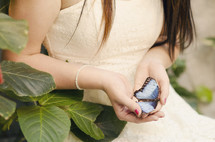 woman holding a butterfly