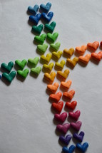 a cross made of many colorful hearts – his love for us.