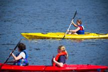 rowing in kayaks