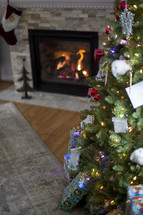 presents under a Christmas tree and fireplace