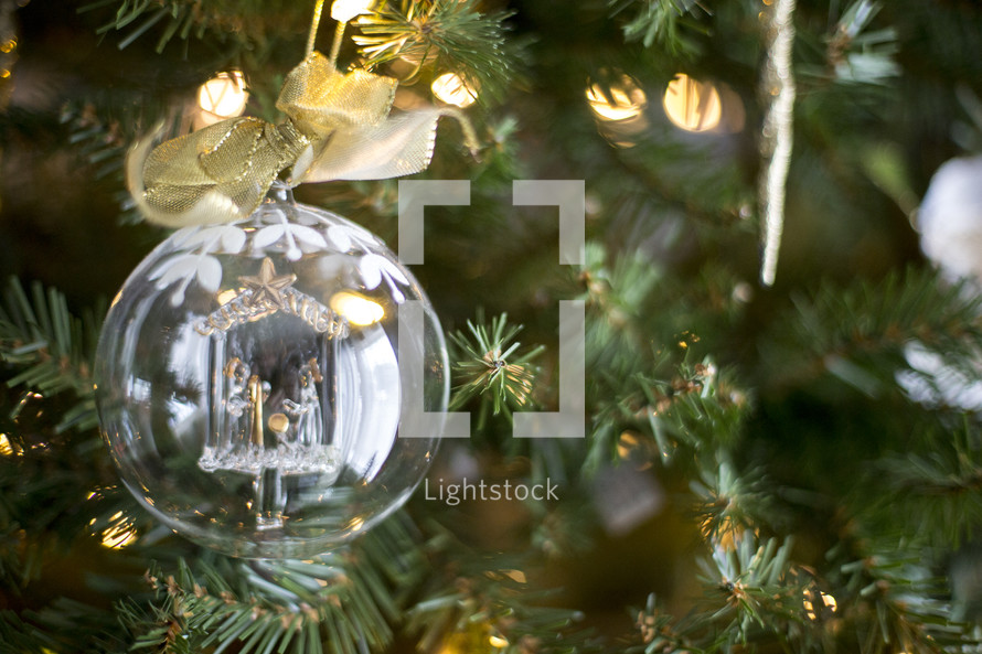 clear glass ornament on a Christmas tree