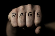 The word RAGE written on a fist. 