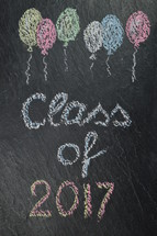 chalk on slate with balloons and the words: class of 2017