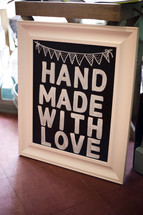 "Sign reading ""hand made with love."""