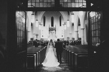 father leading his bride daughter down the aisle