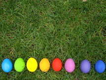 Multicolored Easter eggs in the grass.