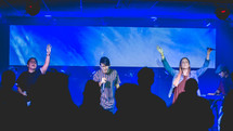 worship leaders on stage with microphones