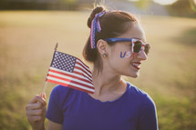 woman holding an American flag for July 4th