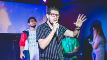 worship leaders on stage singing