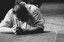 a man praying at the altar