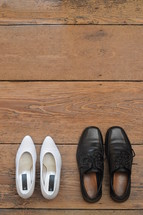 wedding shoes next to each other facing the same direction.