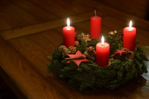 Three candles are burning at the Advent wreath for the third advent.  advent, candle, Christmas, candles, four, three, two, one, lit, light, bright, burn, burning, wreath, birth, Jesus, born, waiting, wait, flame, flames, red, arrive, arriving, come, coming, await, await arrival, arrival, anticipated, anticipate, anticipating, expected, expect, expecting, awaited, long-awaited, hope, hoping, desiderated, longed, longed for, long-yearned-for, crave, desire, long, desiderate, longing, craving, desiring, fir, fir branch, branch, fir-bough, cone, fir cone, pine, pine cone, quiet, time, Christmas story, nativity, nativity story, countdown, count, third, third advent